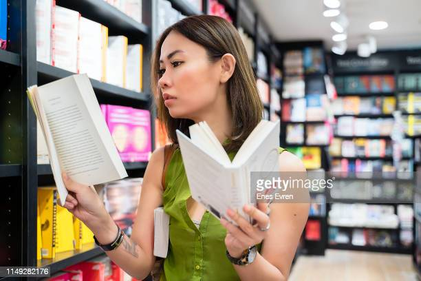 Female student searching for books in the book store