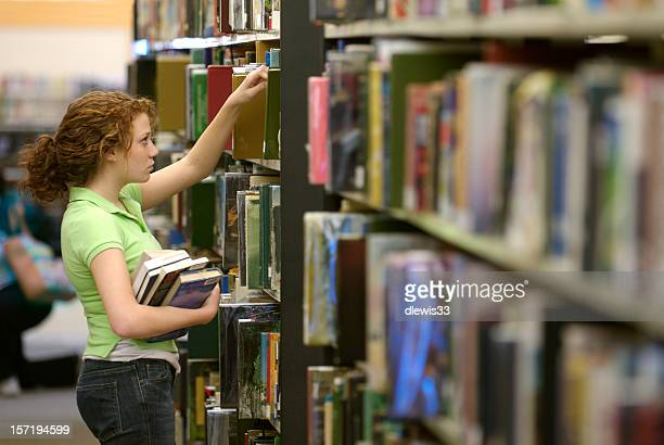 Female Student Selecting a Library Book