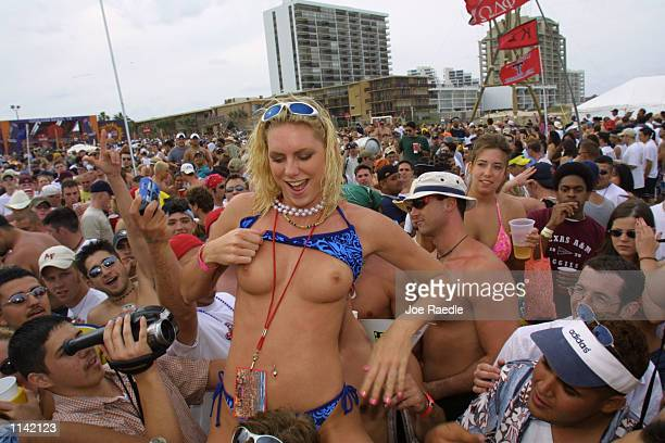 A female student shows her breasts on the beach at South Padre Island Texas March 16 2001 during the annual rite of Spring Break Some 125000 revelers...
