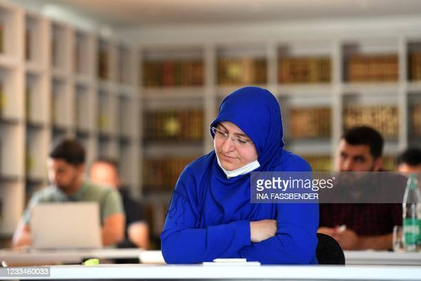 Female student takes part in a Qur'an recitation lesson at the Islamkolleg Deutschland in Osnabrueck, western Germany on June 14, 2021. - The first...