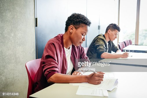 Female student taking exam at college