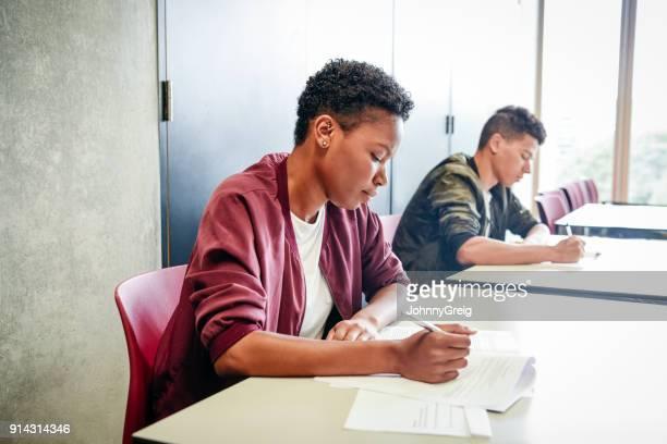 Female student taking exam at college