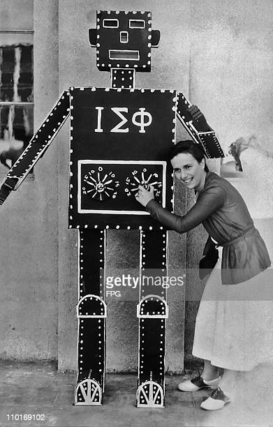 A female student with a robot at a fraternity party at San Jose State University circa 1933