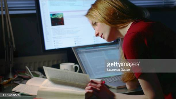 female student working - authors stock pictures, royalty-free photos & images