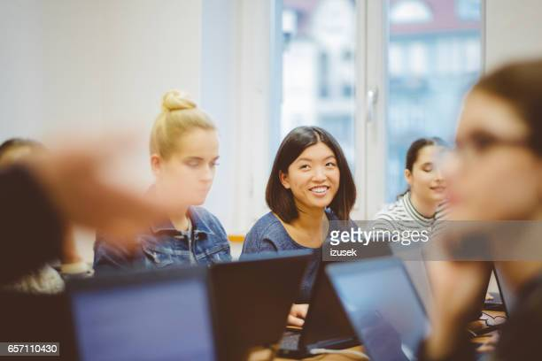 female students during computer programming class - college classroom stock photos and pictures