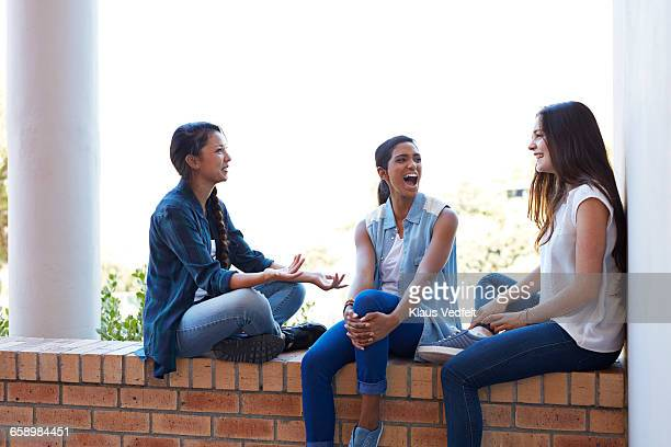 Female students having laughing on staircase