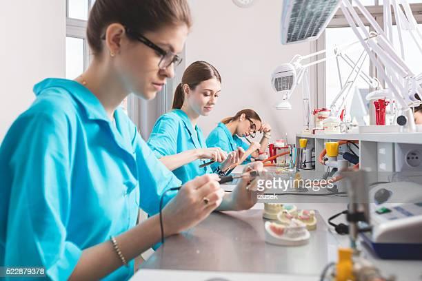 Female students learning prosthetic dentistry
