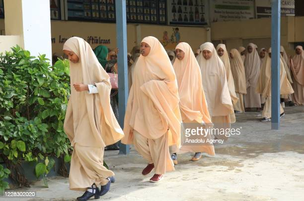 Female students move to their classrooms while maintaining distance as schools begin in the Somalian capital Mogadishu on September 01 2020 under the...