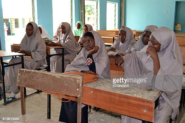 Female students of government college listen to a lecture in a classroom following the reopening ceremony of public schools in Maiduguri northeast...