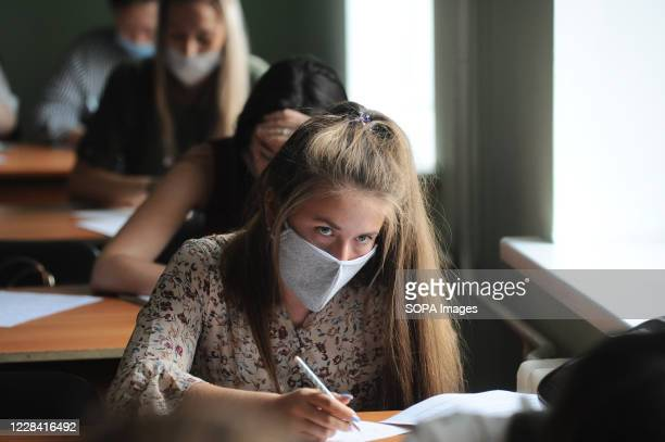 Female students of Tambov University are seen wearing protective masks in the classroom as a precaution against Covid-19. Students at many Russian...