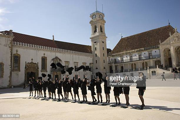 Female students of the Old University of Coimbra at a photoshoot practicing for their graduation ceremony in the Paco das Escolas square Behind them...