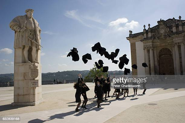 Female students of the Old University of Coimbra at a photoshoot practicing for their graduation ceremony in the Paco das Escolas square On the left...