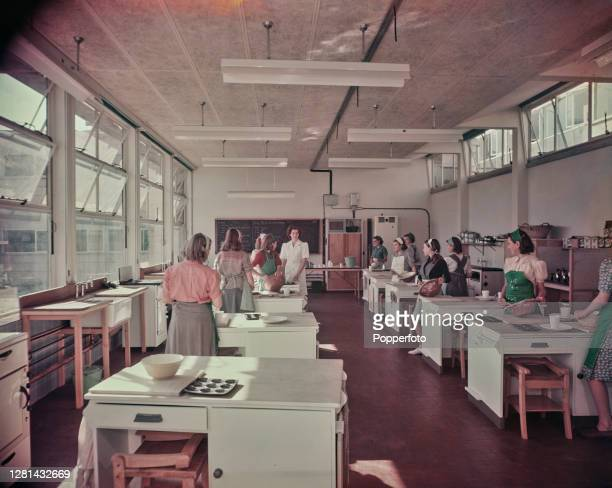 Female students on a domestic science course take part in a cookery class in a classroom kitchen at Barclay Secondary Modern School in Stevenage,...