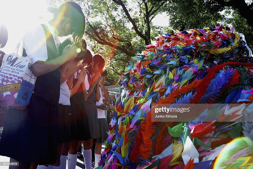 Female students pray for A-bomb victims in front of thousands of paper-made birds which represent peace, at the Peace Memorial Park on August 5, 2004 in Hiroshima, Japan. Tomorrow Hiroshima will mark the 59th anniversary of the dropping of the first atomic bomb in Hiroshima at the Hiroshima Peace Memorial Park.