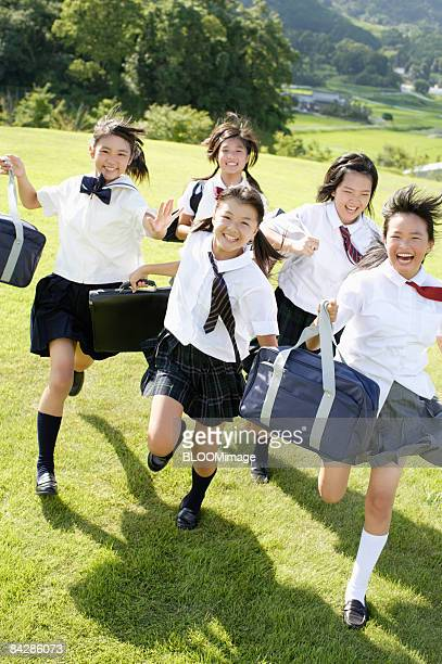 Female students running on grass