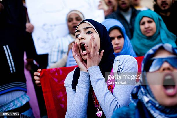 Female students shout slogans in front of the Cairo University during a protest against the military rulers of the country on February 11 2012 in...