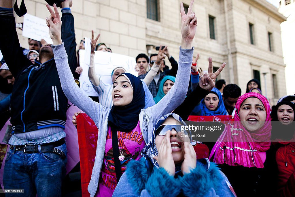 Female students shout slogans in front of the Cairo University during a protest against the military rulers of the country on February 11, 2012 in Cairo, Egypt. Today is the first anniversary of the resignation of the former Muhammad Hosni Mubarak after his 30-year term on 11 February last year. The poor economic condition of the country and the unrest in the past are a threat to the transition to a democracy.