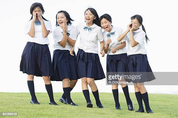 female students shouting, smiling - female high school student stock pictures, royalty-free photos & images