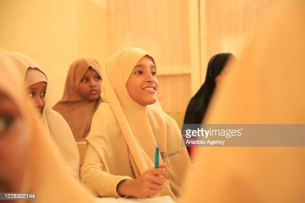Female students take a class as schools begin in the Somalian capital Mogadishu on September 01 2020 amid the coronavirus pandemic