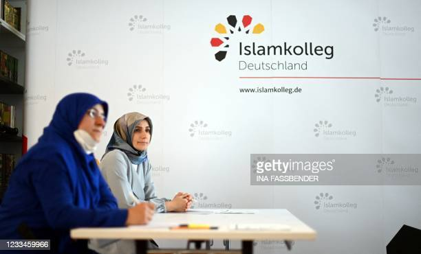 Female students take part in a Qur'an recitation lesson at the Islamkolleg Deutschland in Osnabrueck, western Germany on June 14, 2021. - The first...