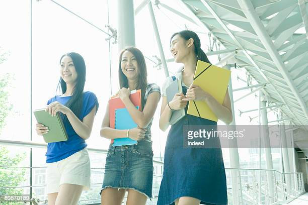 female students walking on corridor - japanese short skirts stock photos and pictures