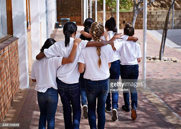 Female students walking together in schoolyard