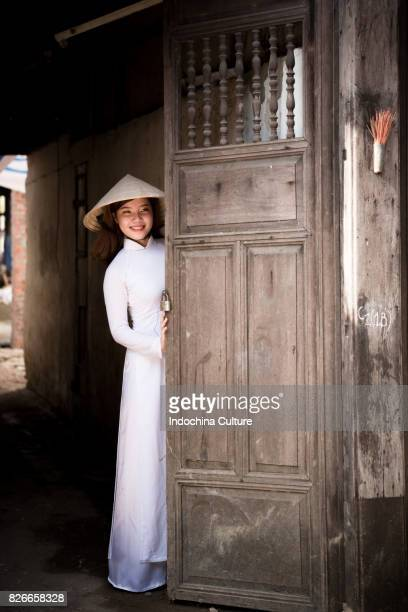 female students wearing vietnamese ao dai at ancient town hoi an, vietnam - long dress stock pictures, royalty-free photos & images