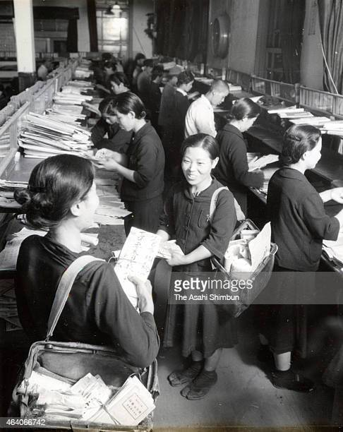 Female students work as postman at Kokura Post Office circa March 1943 in Kokura Fukuoka Japan Due to lack of the domestic working force at the end...