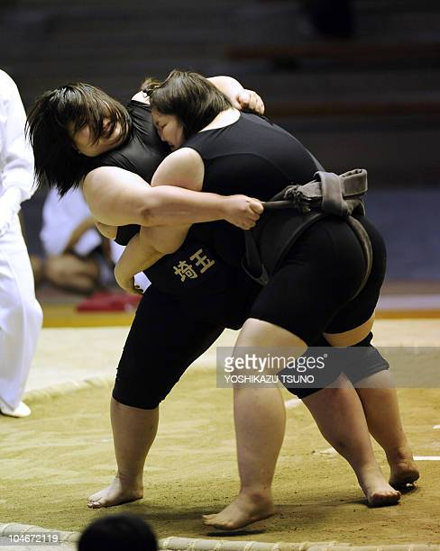Female sumo wrestlers fight on the ring during the open class of the Japan women's sumo championships in Sakai city southern Osaka on October 3 2010...