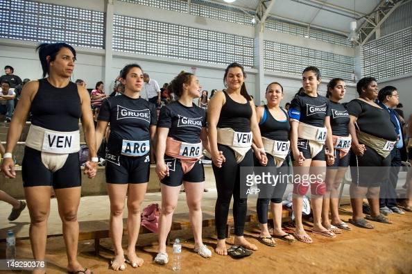 Japans women wrestlers take on sumos big boys