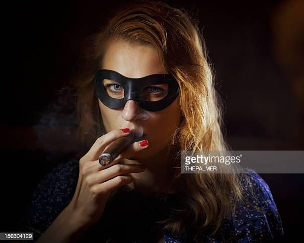female superhero smoking in the dark