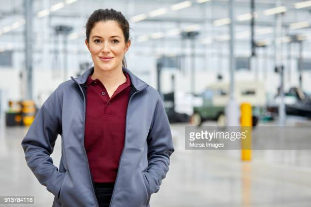 Female supervisor with hands in jacket's pockets