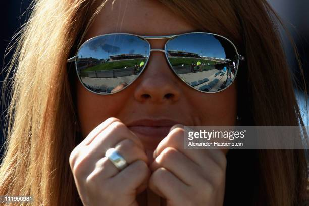 A female supporter looks on during the Third League match between SpVgg Unterhaching and Eintracht Braunschweig at Generali Arena on April 10 2011 in...