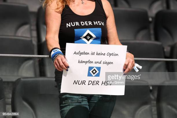 A female supporters of Hamburg displays a sign 'To give up is not an option fight and win Only HSV' before the Bundesliga match between Eintracht...