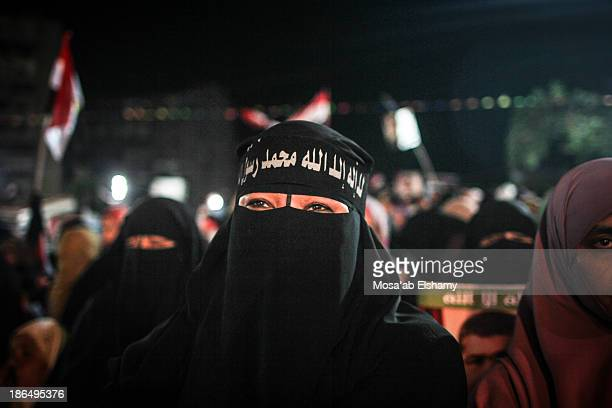 CONTENT] A female supporters of ousted president Mohamed Morsi is seen in Rabaa Adaweya camp Cairo Egypt
