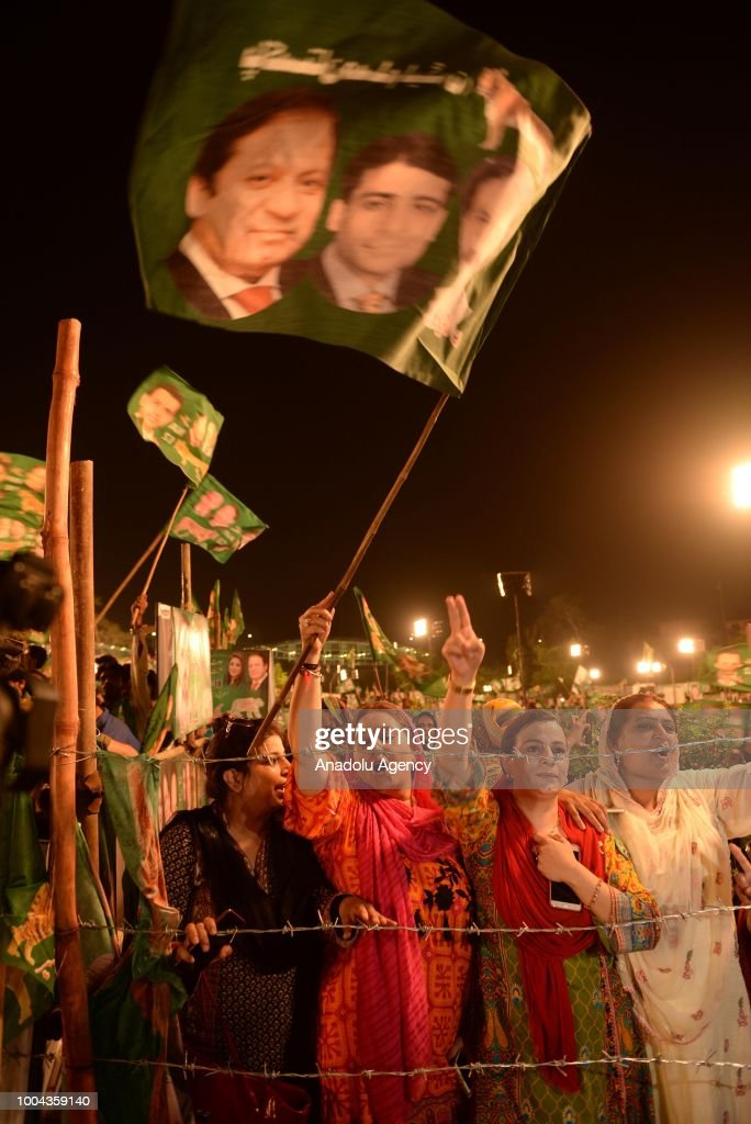 Female supporters of Pakistan Muslim LeagueNawaz hold party flags bearing an image of ousted Prime Minister Nawaz and his nephew Hamza Shahbaz as...