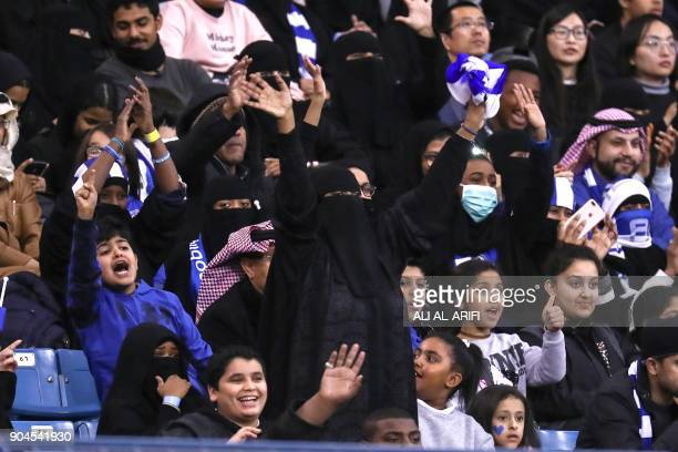 Female supporters of Saudi's AlHilal attend their team's football match against AlIttihad in the Saudi Pro League at the King Fahd International...