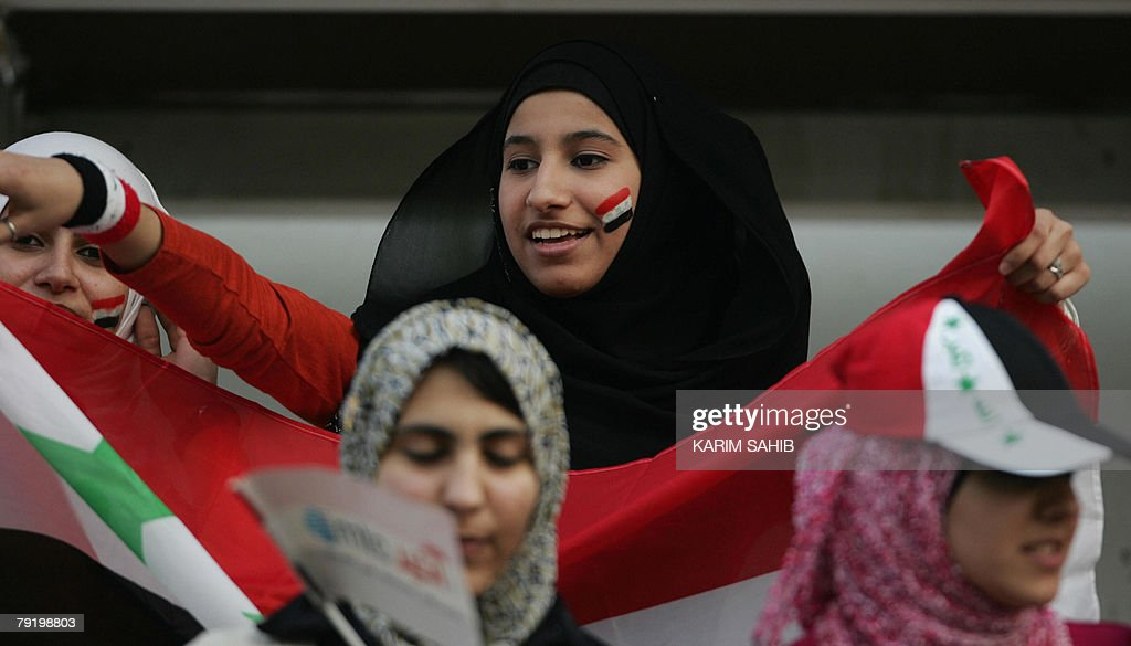 Female supporters of the Iraqi national football team wave Iraqi flags during a friendly match against Jordan in Dubai 24 January 2008. The game ended in a 1-1 draw.