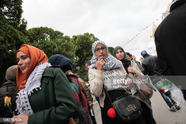 Female supporters of the Tunisia's islamist Ennahda party are holding roses as they attend the celebrations of the Revolution Day the heightyear...