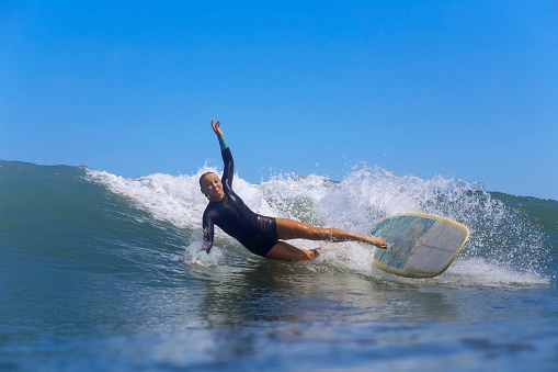 Female surfer falling off surfboard while riding wave, Male, Maldives - gettyimageskorea