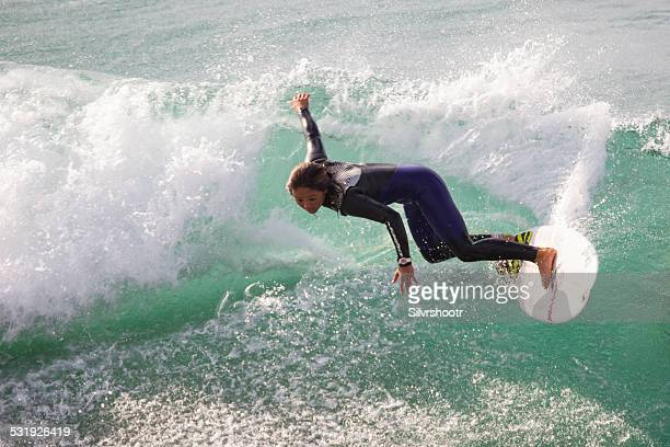 Female surfer on a wave at Oceanside California
