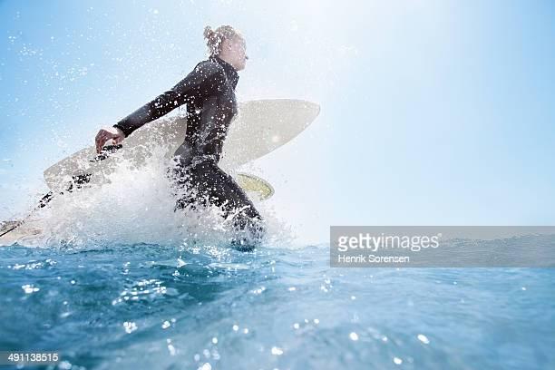 Female surfer on the beach