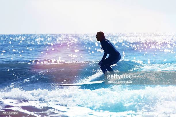 female surfer riding the wave - surf ストックフォトと画像