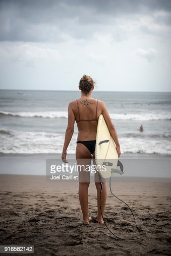 Female surfer with tattoo of world map in bali stock photo getty female surfer with tattoo of world map in bali stock photo getty images gumiabroncs Gallery