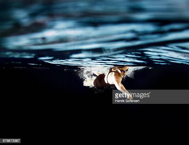 Female swimmer af the surface of water