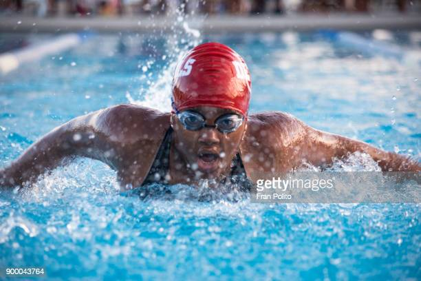 female swimmer at a swim meet. - sporting term stock pictures, royalty-free photos & images