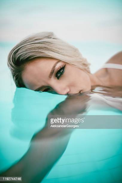 female swimmer diving in pool - diving to the ground stock pictures, royalty-free photos & images