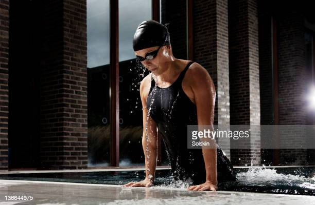 female swimmer getting out of pool