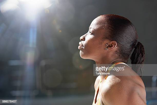 female swimmer looking up to sun