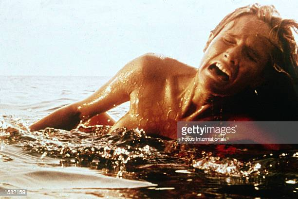 A female swimmer screams as she is attacked by a giant Great White shark in a still from the film 'Jaws' directed by Steven Spielberg 1975